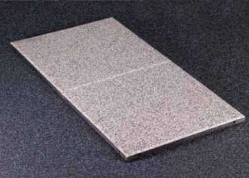 Sound absorbing floor tiles